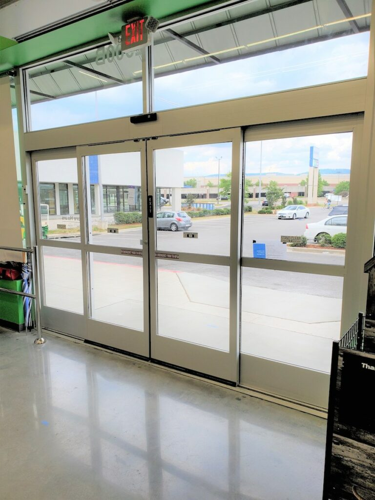 Shot of functional automatic sliding door from the inside of Pet Supplies Plus, new construction