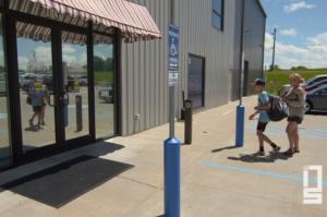 Patrons entering through an automatic door