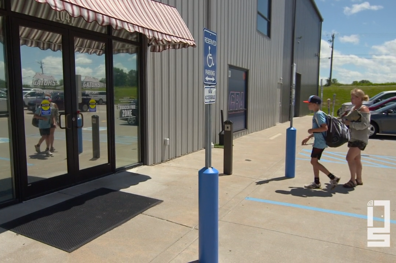 Patrons entering through an automatic door