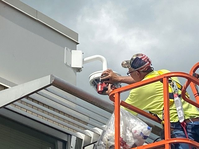 Technician installs security camera